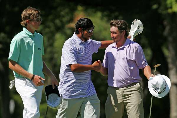 Levi Valadez (right) is congratulated by his caddie, Angelo Leyvani (center) after winning the 2016 Greater Antonio Junior Amateur golf tournament on Thursday, July 21, 2016. At left is second-place finisher Christian Fanfelle.