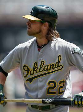 MINNEAPOLIS, MN - JULY 06: Josh Reddick #22 of the Oakland Athletics reacts to fouling out against the Minnesota Twins during the fourth inning of the game on July 6, 2016 at Target Field in Minneapolis, Minnesota. The Twins defeated the Athletics 4-0. (Photo by Hannah Foslien/Getty Images)