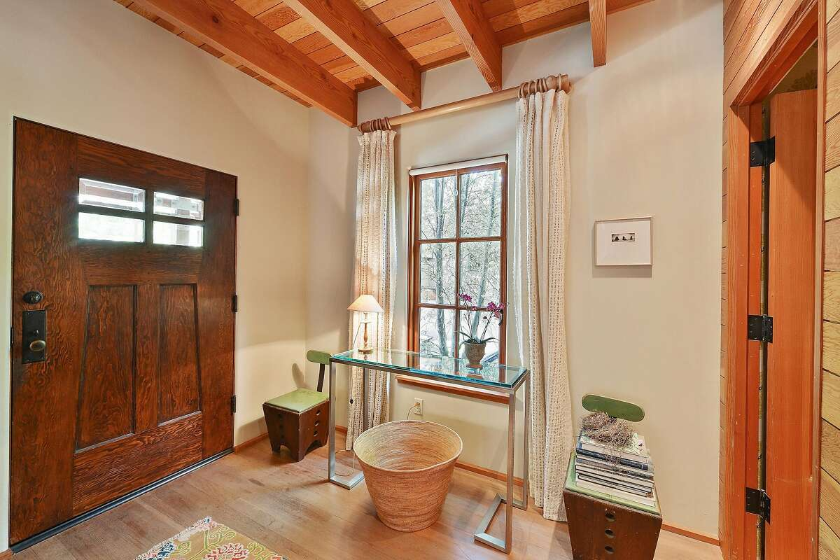Architectural finishes within the home include Douglas fir flooring and casement windows.