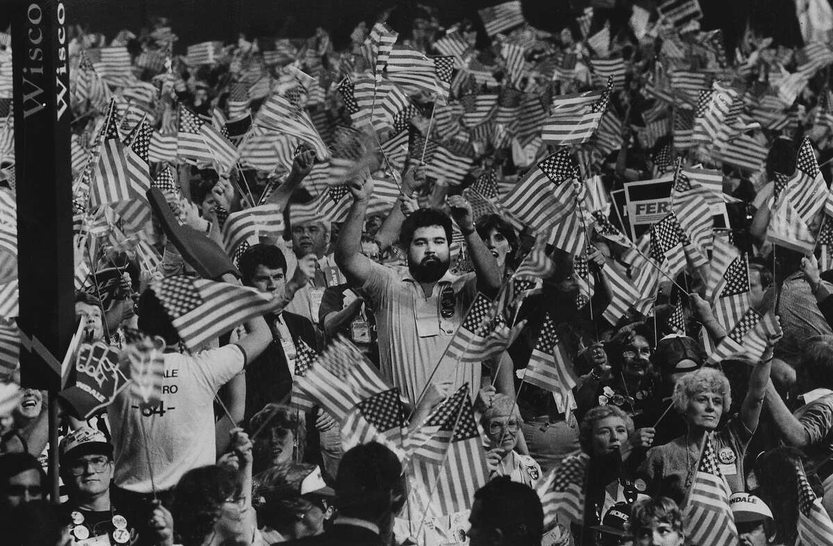 Delegates wave flags at the 1984 Democratic National Convention held at Moscone Center in San Francisco Photo ran 07/20/1984, P. 5
