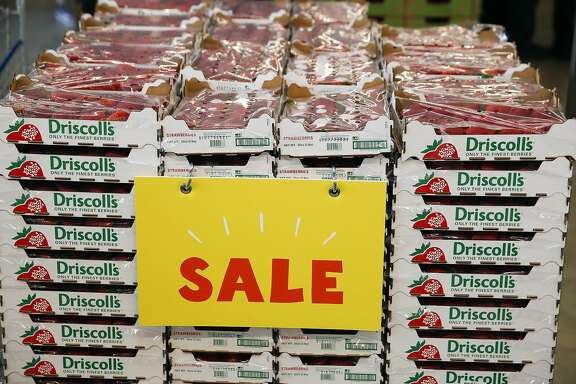 Driscoll's brand strawberries are displayed for sale on the opening day of the 365 by Whole Foods Market store in the Silver Lake neighborhood of Los Angeles, California, U.S., on Wednesday, May 25, 2016. Whole Foods Market Inc., plans to open 10 of the grocery stores in 2017 with a focus on everyday low prices and convenience. Photographer: Patrick T. Fallon/Bloomberg