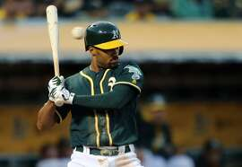OAKLAND, CA - JULY 18:  Marcus Semien #10 of the Oakland Athletics avoids being hit by a pitch in the bottom of the fourth against the Texas Rangers at the Oakland Coliseum on July 18, 2016 in Oakland, California.  (Photo by Don Feria/Getty Images)