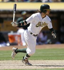 Oakland Athletics' Josh Reddick swings against the Toronto Blue Jays in the seventh inning of a baseball game Saturday, July 16, 2016, in Oakland, Calif. (AP Photo/Ben Margot)