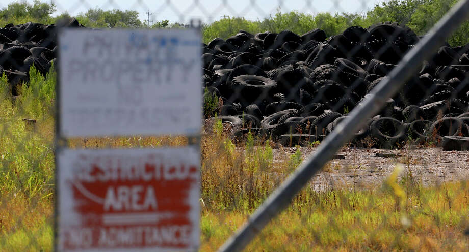This is just a portion of the millions of tires at the former Safe Tire Disposal Corp. on Applewhite Road on the City's South Side. A state judge ordered the current owner to remove most of the tires from the dump. Photo: John Davenport /San Antonio Express-News / ©San Antonio Express-News/John Davenport