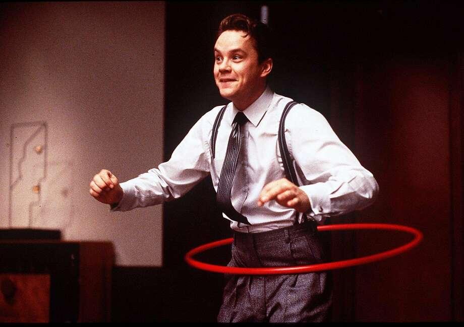 "Tim Robbins stars in the Coens' film ""The Hudsucker Proxy."""