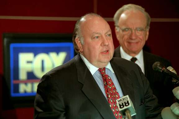 FILE - In this Jan. 30, 1996 file photo, Roger Ailes, left, speaks at a news conference as Rupert Murdoch looks on after it was announced that Ailes will be chairman and CEO of Fox News. 21st Century Fox said Thursday, July 21, 2016, that Ailes is resigning immediately. Murdoch will assume the role of Chairman and acting CEO of Fox News Channel and Fox Business Network. (AP Photo/Richard Drew, File)
