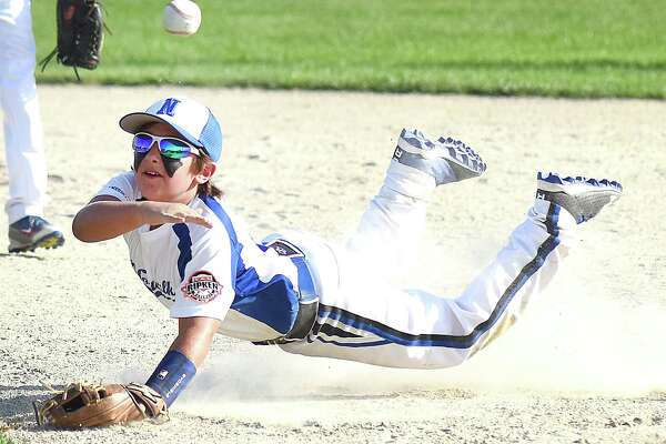 Norwalk Cal Ripken All-Star second baseman Sean Lengyel makes a diving throw to first base for an out during Thursday's New England Regional championship game against Dover, N.H., at Quigley Field in Uxbridge, Mass. Norwalk won the game, 13-3.
