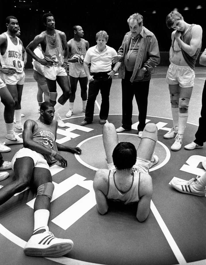 03/28/1983 - Houston's top-ranked Cougars listen to Coach Guy Lewis during Monday's practice at Hofheinz Pavilion. The Cougars include (CW from lower left): Akeem Olajuwon, Derek Giles, Clyde Drexler, Alvin Franklin, manager Jimmy Duffer, coach Lewis, Reid Gettys and David Rose. Lewis' Coogs are preparing for Saturday's game against Louisville in the NCAA semifinals at Albuquerque, NM. Photo: Betty Tichich, HP Staff / Houston Chronicle