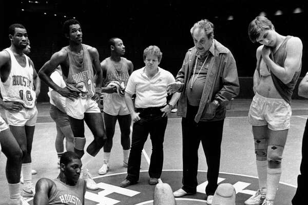 03/28/1983 - Houston's top-ranked Cougars listen to Coach Guy Lewis during Monday's practice at Hofheinz Pavilion. The Cougars include (CW from lower left): Akeem Olajuwon, Derek Giles, Clyde Drexler, Alvin Franklin, manager Jimmy Duffer, coach Lewis, Reid Gettys and David Rose. Lewis' Coogs are preparing for Saturday's game against Louisville in the NCAA semifinals at Albuquerque, NM.