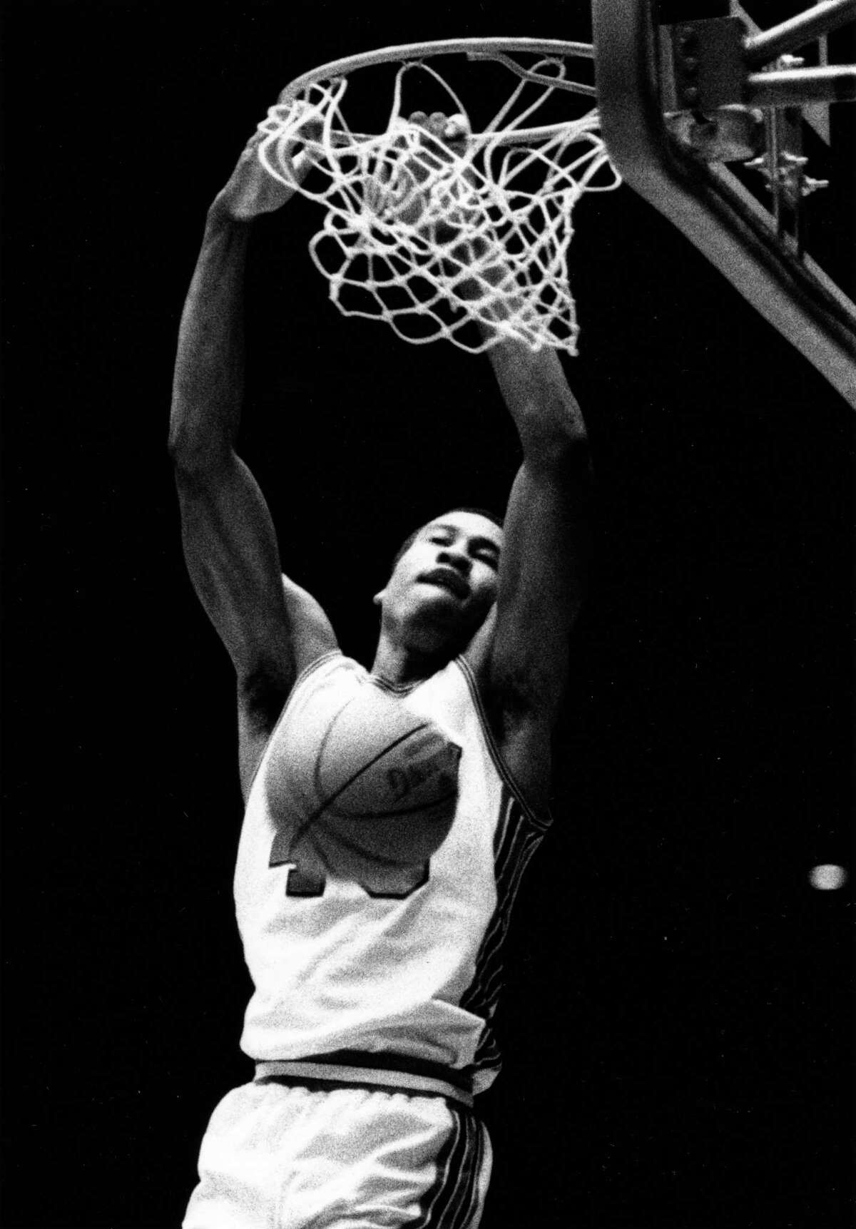 12/1979 - Houston Cougars Larry Micheaux (40) rips net on a dunk in Hofheinz Pavilion.
