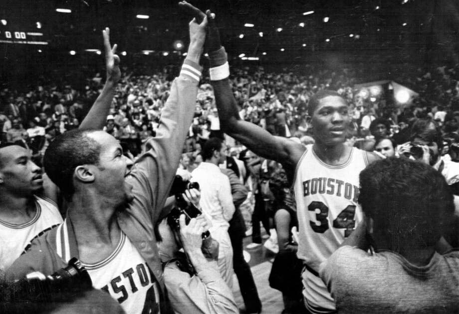 04/02/1983 - Houston Cougars celebrate their win against Louisville with high-fives in the NCAA Tournament Final Four semifinal at The Pit in Albuquerque, New Mexico Photo: Fred Bunch, HP Staff / Houston Chronicle
