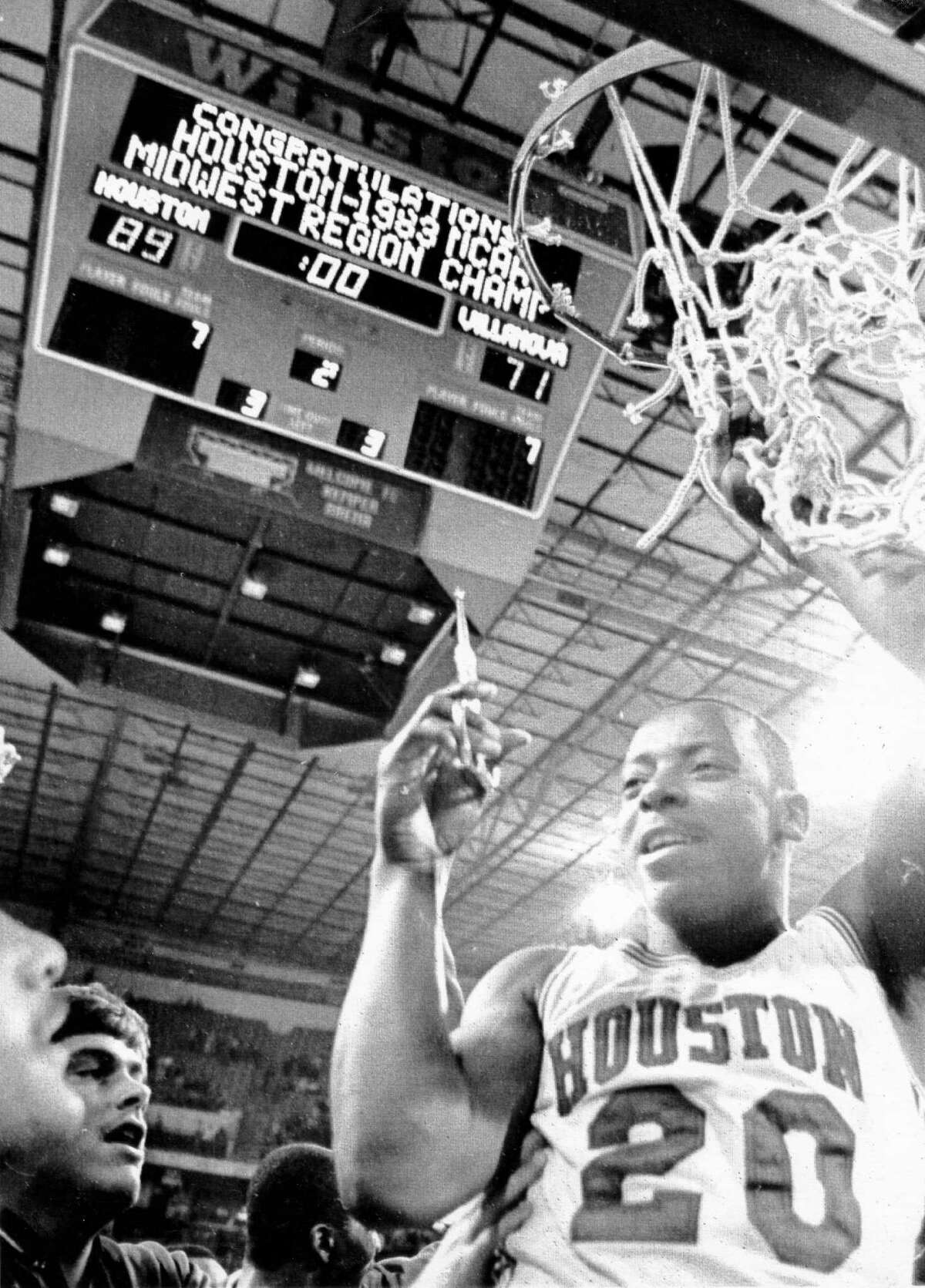 03/27/1983 - Houston Cougars guard Alvin Franklin (20) snips a souvenir piece of the net after UH defeated Villanova in the Midwest Regional Final of the NCAA Tournament at Kemper Arena in Kansas City, Missouri.