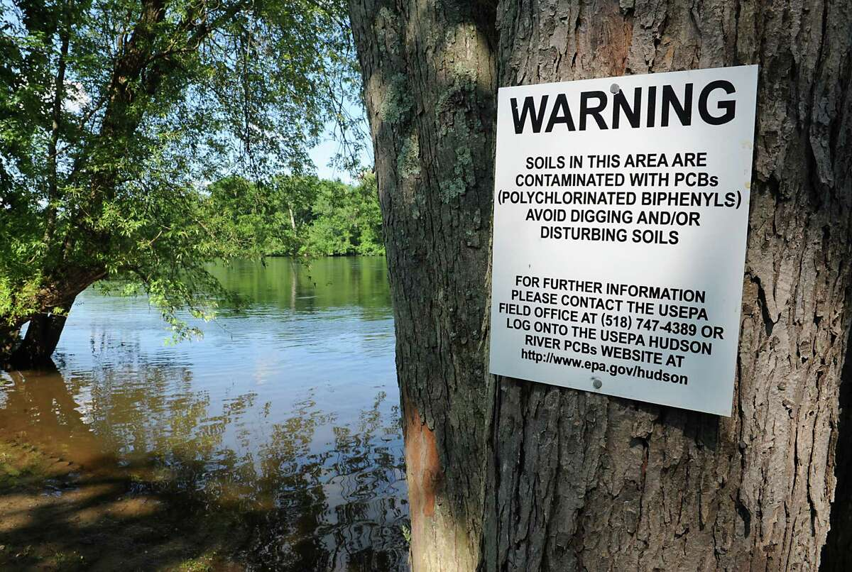 Signs are posted at the kayak launch at Hudson Crossing Park to warn boaters of potential exposure to polychlorinated biphenyls (PCB's) Friday, June 27, 2014 in Schuylerville, N.Y. (Lori Van Buren / Times Union archive)