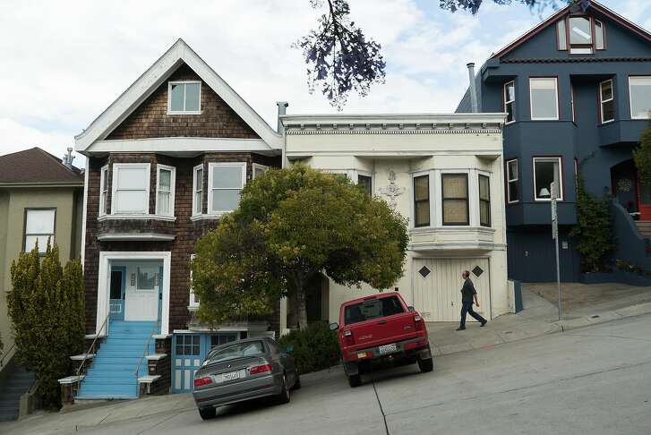 A man walks down Texas Street in Potrero Hill where Brian and Sarah Grzybowski live in San Francisco, Calif. on Saturday, June 18, 2016. The Grzybowski's rented a home for five years until their landlord evicted them last year.