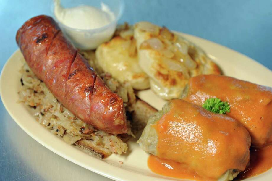 The Polish Platter features kielbasa and kapusta on Polish rye, golabkis and potato cheese pierogis on Thursday, July 14, 2016, at Chester's Smokehouse in Troy, N.Y. (Cindy Schultz / Times Union) Photo: Cindy Schultz / Albany Times Union