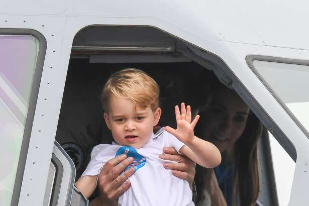 FAIRFORD, ENGLAND - JULY 08:  Prince George of Cambridge waves from the cockpit of a plane as he attends the The Royal International Air Tattoo at RAF Fairford on July 8, 2016 in Fairford, England.  (Photo by Samir Hussein/WireImage)