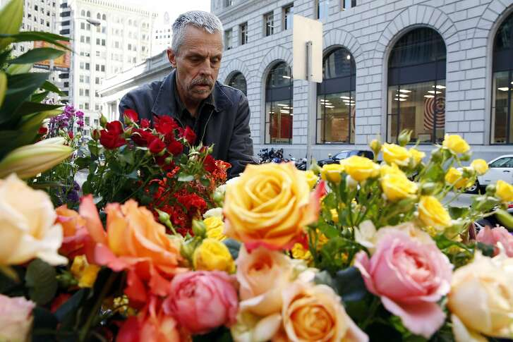 Michael Scurlock selects flowers for bouquets at Elizabeth's Flowers in downtown San Francisco, California, on Thursday, July 21, 2016.