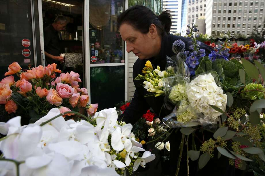 Elizabeth Idzkowski picks out flowers for an arrangement at her store Elizabeth's Flowers in downtown San Francisco, California, on Thursday, July 21, 2016. Photo: Connor Radnovich, The Chronicle