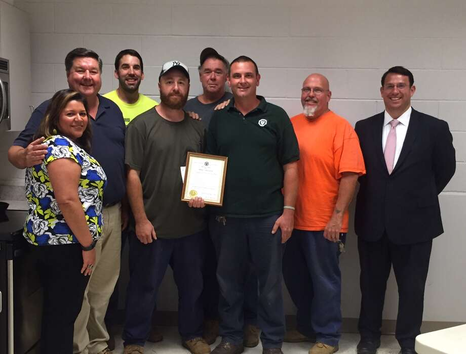 Craig George, Gary Brown, Dan Sennett and Nick Digioia, the Sewer Line Crew in the Wastewater Division within the Department of Public Works were selected as Employees of the Month for July 2016. From left are Human Resources Director Tania Barnes, Wastewater Superintendent Ed Kozlowski, Sumner Johnston, Nick Digioia ,Gary Brown, Craig George, Dan Sennett and Mayor Ben Blake. Photo: Contributed Photo / Connecticut Post