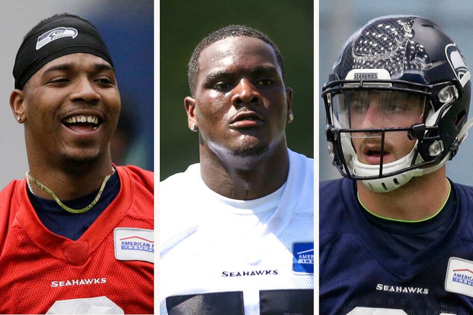 (L to R) Quarterback Trevone Boykin, defensive end Frank Clark and tight end Nick Vannett are among the Seahawks players with the most to gain as training camp kicks off next week. Photo: Associated Press
