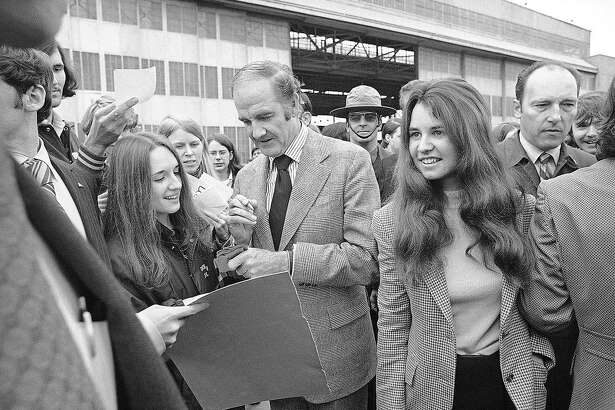 U.S. Sen. George McGovern, accompanied by Kathleen Kennedy, right, signs his autograph during a campaign stopover on April 24, 1972 at the Harrisburg International Airport in his quest for votes in Pennsylvania?s primary. McGovern is candidate for Democratic nomination for President. Kathleen is eldest daughter of late U.S. Sen. Robert Kennedy. (AP Photo/PV)