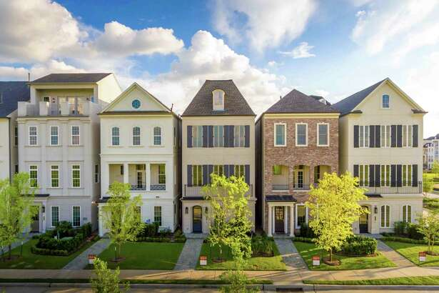 Ranging from 2,600 to 4,600 square feet, the three- and four-story Regency, Georgian and Normandy-style homes line the paved streets along canals, lakes and gathering places. They are priced starting in the upper $500,000s.