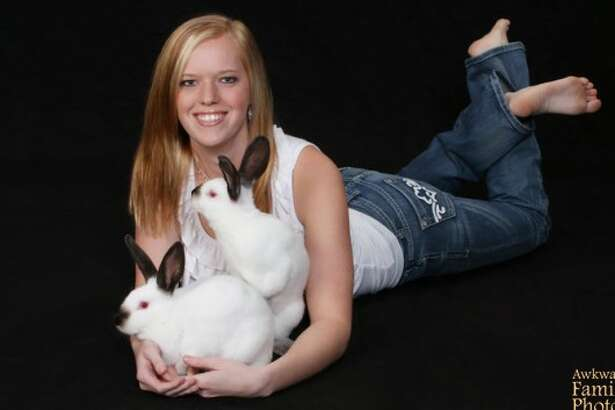 "Rabbit romance: ""This is a photo of me with my rabbits for my senior pictures. Little did I know that they would want to do the nasty in front of the camera."""