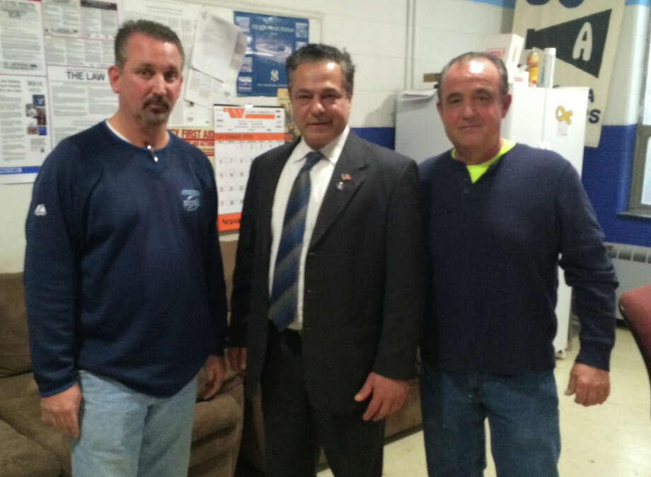 Kevin Cegelka, left, was named Ansonia's DPW foreman, Mayor David Cassetti and Public Works Supt. Mike D'Alessio, Photo: Mike Mayko / Hearst Connecticut Media / Connecticut Post