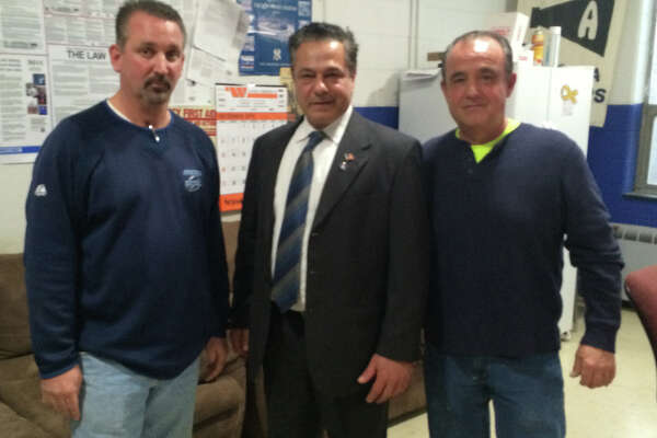 Kevin Cegelka, left, was named Ansonia's DPW foreman, Mayor David Cassetti and Public Works Supt. Mike D'Alessio,