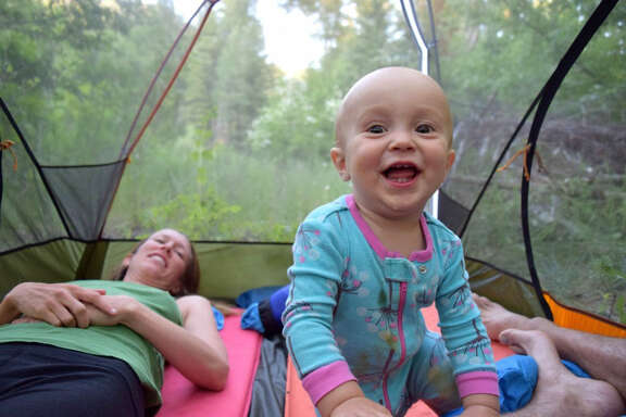 Camping gear can be entertaining for young children like Talon, shown in a tent in the Rattlesnake Wilderness, Mont.