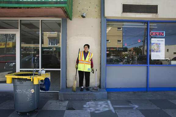 """Suu Ngo, 67, cleans the sidewalks and streets along Irving Street on Thursday, July 21, 2016 in San Francisco, Calif. Ngo, who is originally from Vietnam, has been cleaning the streets for the Department of Public Works for the past five years since leaving the restaurant business after 27 years. """"I'm happy here,"""" she says of her cleaning route which starts at 9th and Irving, """"Everybody is nice to me, respects me."""" Ngo works to help support her three grandchildren who she raised after her daughter died."""