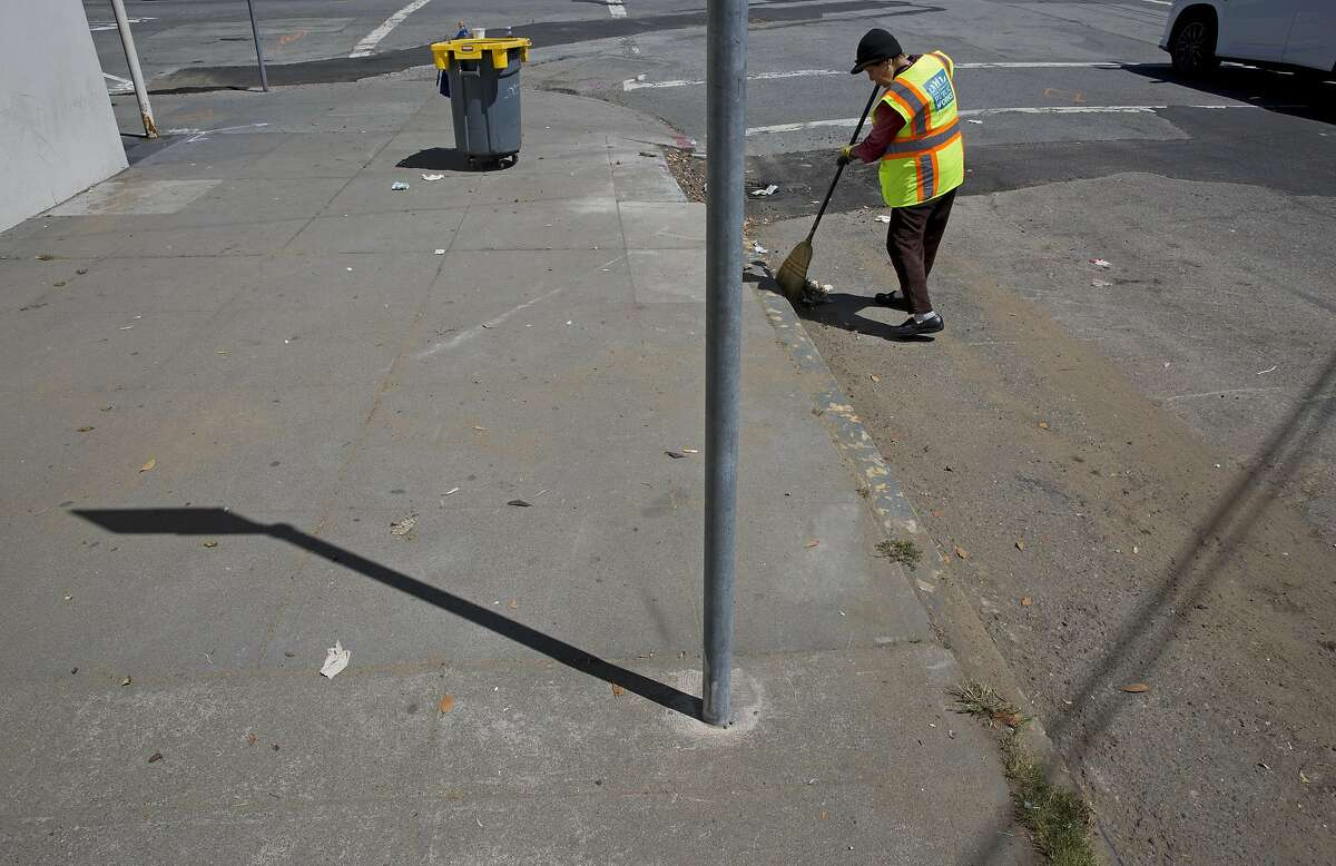 Suu Ngo, 67, cleans the sidewalks and streets along Irving Street on Thursday, July 21, 2016 in San Francisco, Calif. Ngo, who is originally from Vietnam, has been cleaning the streets with the Department of Public Works for the past five years since leaving the restaurant business after 27 years.