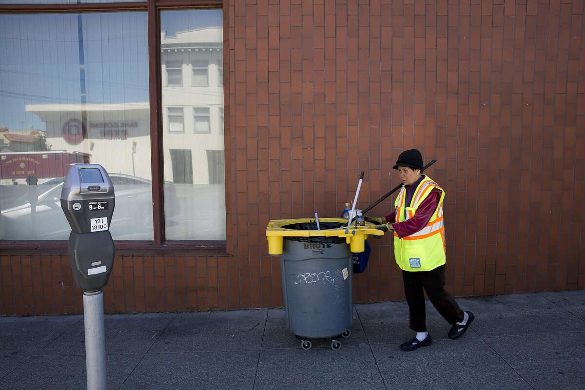 Suu Ngo, 67, cleans the sidewalks and streets near Irving Street on Thursday, July 21, 2016 in San Francisco, Calif. Ngo, who is originally from Vietnam, has been cleaning the streets with the Department of Public Works for the past five years since leaving the restaurant business after 27 years.