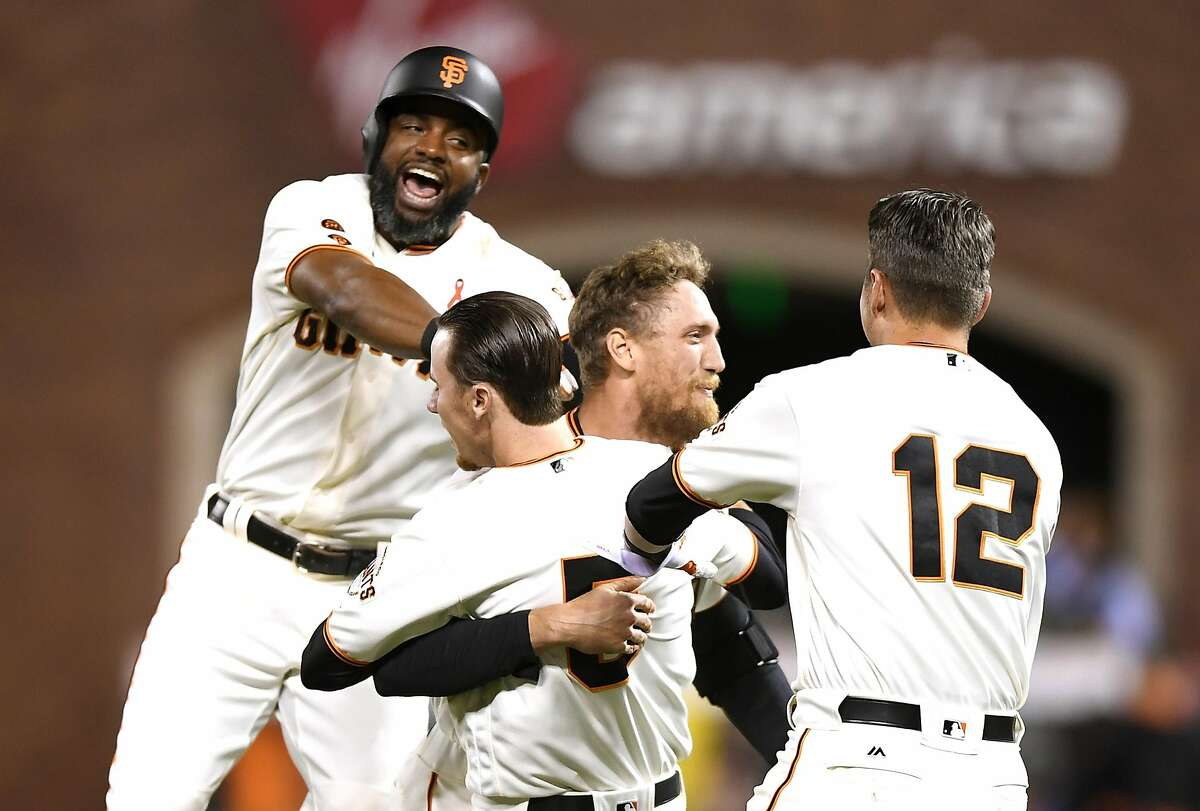 (L-R) Denard Span #2, Matt Duffy #5, Hunter Pence #8 and Joe Panik #12 of the San Francisco Giants celebrates after Pence hit a walk-off rbi single to score Brandon Belt #9 (not pictured) against the San Diego Padres in the bottom of the ninth inning at AT&T Park on May 23, 2016 in San Francisco, California. The Giants won the game 1-0.