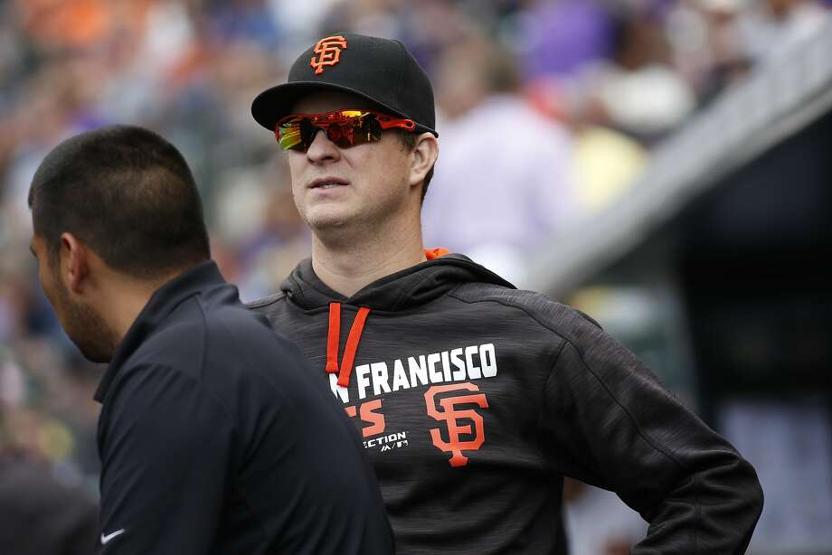 San Francisco Giants starting pitcher Matt Cain looks on from the dugout against the Colorado Rockies in the seventh inning of a baseball game Sunday, May 29, 2016, in Denver. Cain was injured while pitching in the second inning against the Rockies on Friday. (AP Photo/David Zalubowski) Photo: David Zalubowski, Associated Press