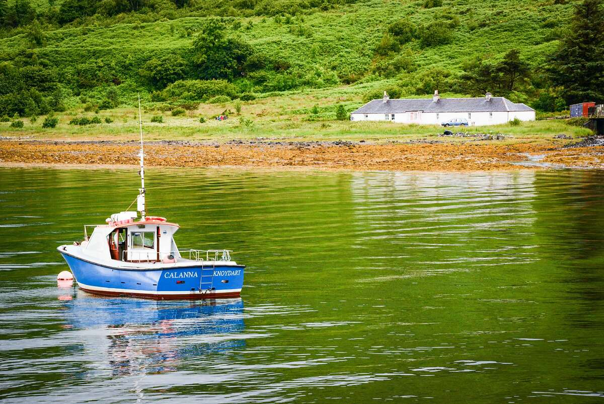 Calm afternoon waters of Loch Nevis at Inverie.