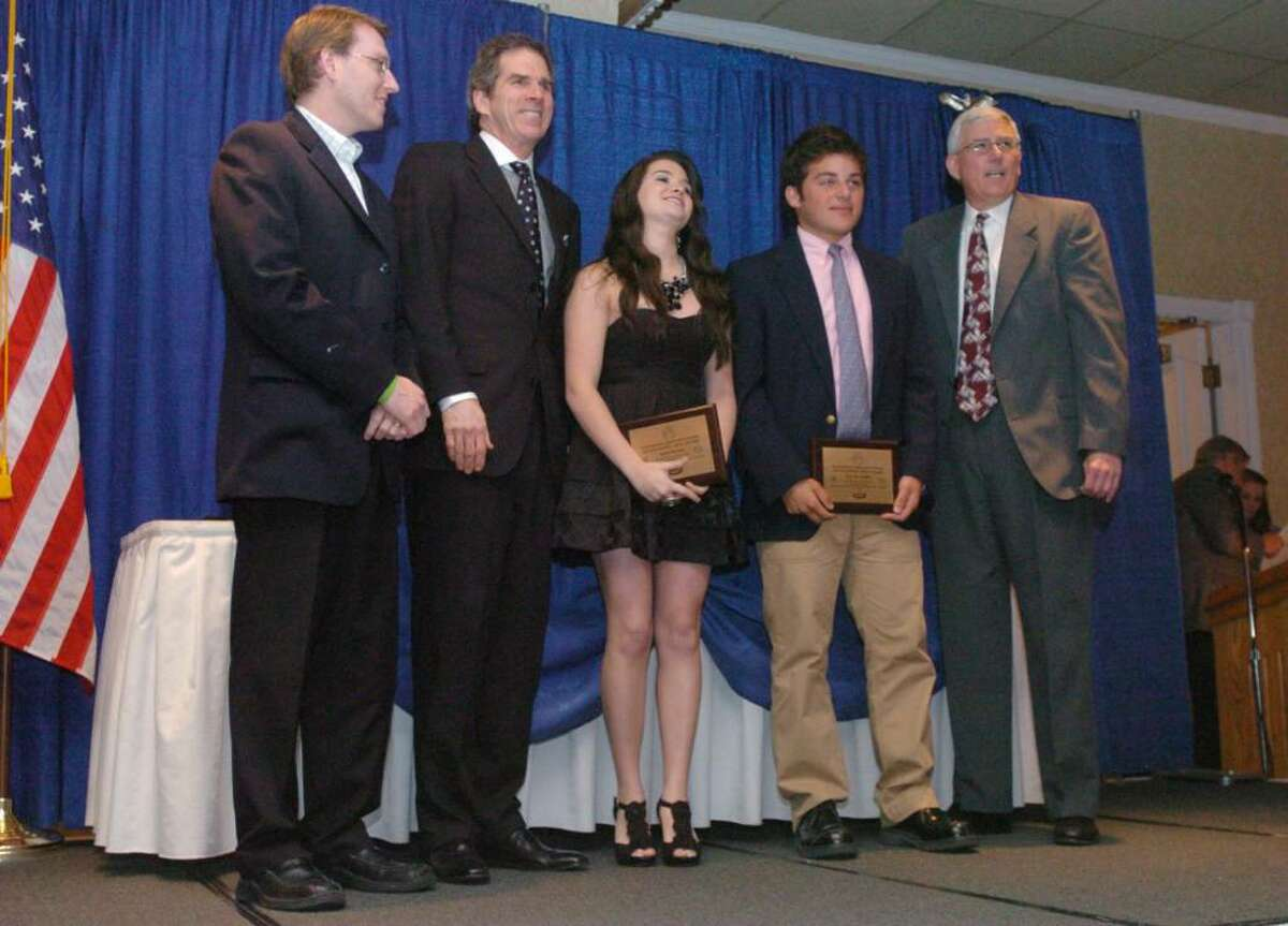 From left, Ryan Ford, of Jostens, Edward Cumming, of the Hartford Symphony Orchestra, Katie Stevens and 17, Eric DeAngelis, 18, of Pomperaug High School and Everett Lyons President of Connecituct Association of Schools stand during the 15th annual arts recognition banquet at the Aqua Turf Tuesday April 27, 2010.