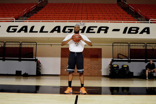 Oklahoma State basketball player Tyrek Coger poses July 6, 2016, in the gym at Gallagher-Iba arena in Stillwater, Okla. Coger died after a 40-minute team workout on the football stadium stairs in hot weather, Thursday, July 21, 2016. (Jimmy Gillispie/Stillwater News Press photo via AP)