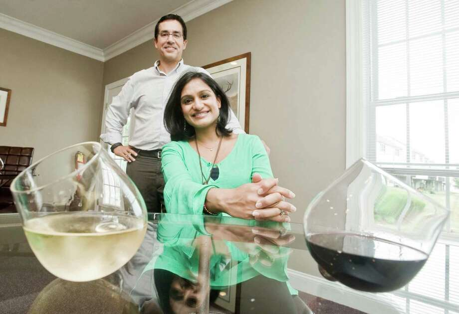 Keven and Ankana Carpenter of Danbury with their Aura Glass spill proof wine glasses. Thursday, July 14, 2016 Photo: Scott Mullin / For The / The News-Times Freelance