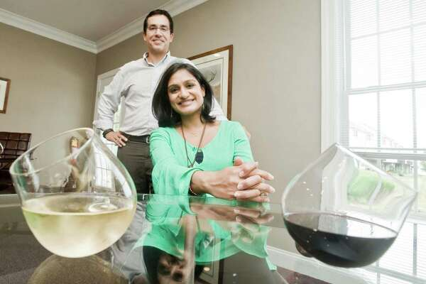 Keven and Ankana Carpenter of Danbury with their Aura Glass spill proof wine glasses. Thursday, July 14, 2016