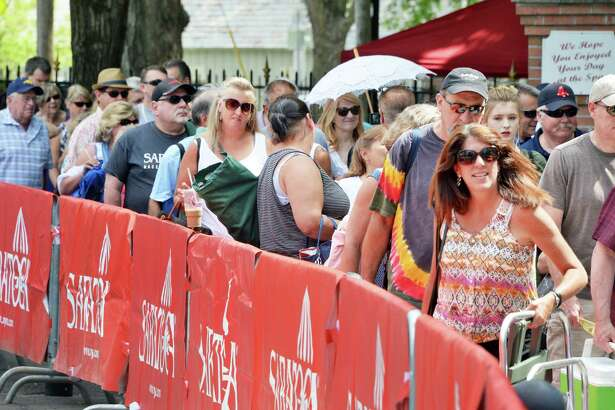 Race fans queue up at the main gate on opening day at Saratoga Race Course Friday July 22, 2016 in Saratoga Springs, NY.  (John Carl D'Annibale / Times Union)