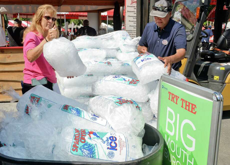 Lucinda Ritchie, left, and Pablo Zuniga of Centerplate stock up on ice as temps are expected to hit 90 on opening day at Saratoga Race Course Friday July 22, 2016 in Saratoga Springs, NY.  (John Carl D'Annibale / Times Union) Photo: John Carl D'Annibale / 20037398A