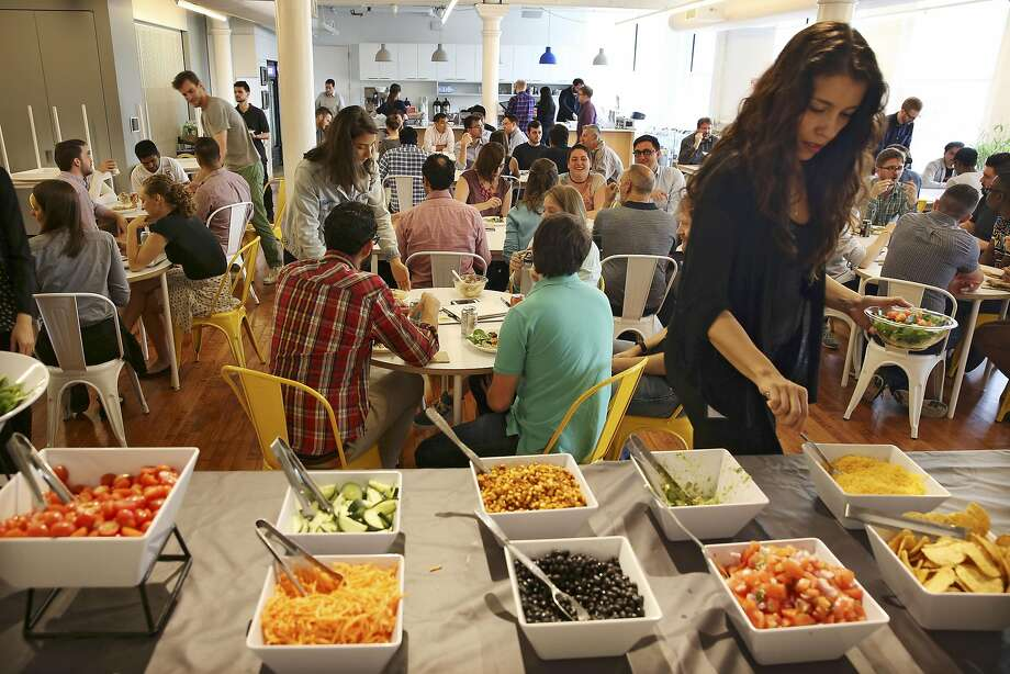 A lunchroom at Oscar Health, which offers a catered lunch for employees a few times a week, at the startup insurer's offices in New York, May 23, 2016. Companies like Oscar were initially attracted by the potential of millions of new customers added to the individual market by the Affordable Car Act, but the reality has been far messier. (Richard Perry/The New York Times) Photo: RICHARD PERRY, NYT