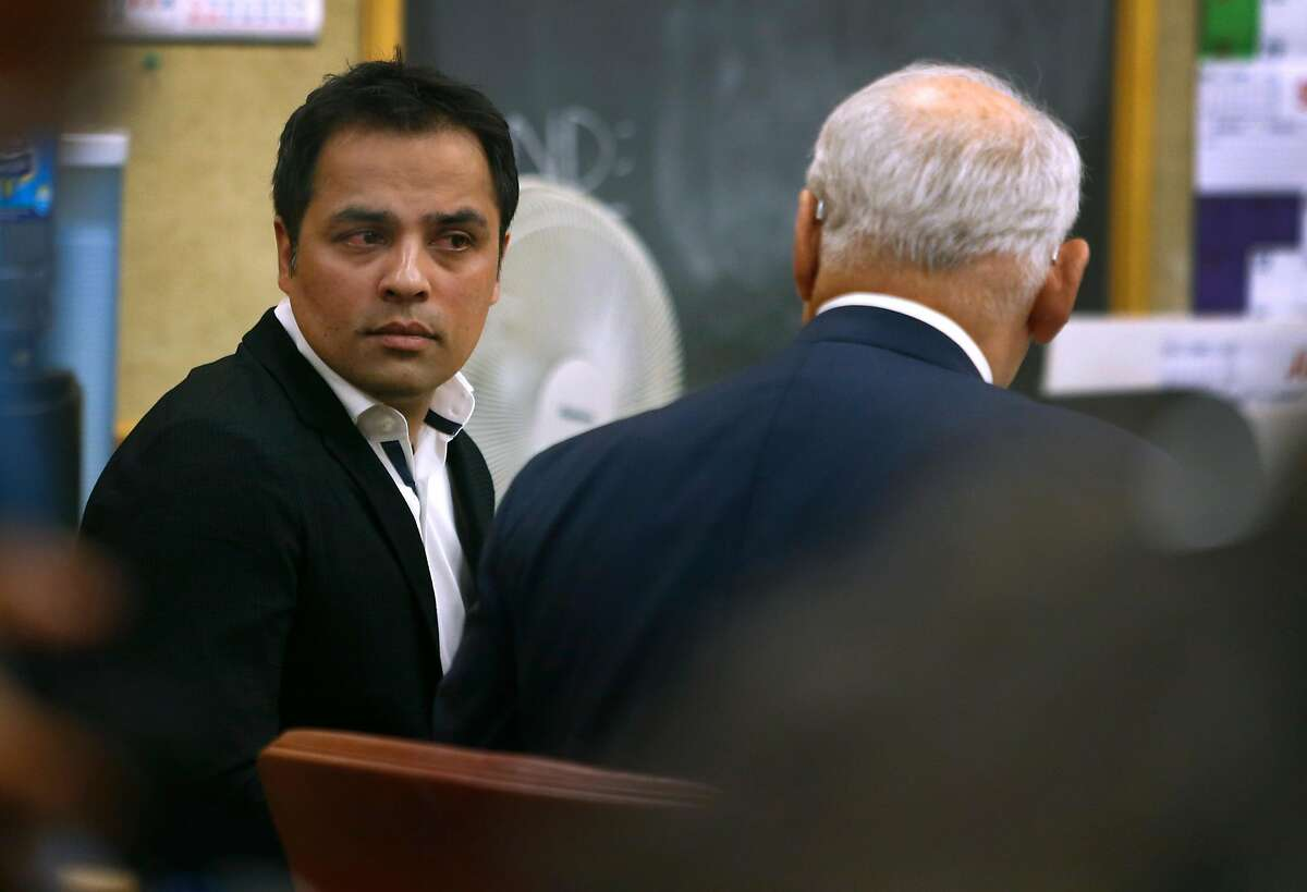 Tech mogul Gurbaksh Chahal speaks with his attorney James Lassart during a hearing to consider revocation of his probation on domestic violence charges in San Francisco, Calif. on Friday, July 22, 2016.