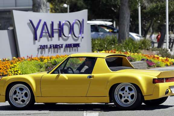 A motorist drives in front of the Yahoo sign at the company's headquarters Tuesday, July 19, 2016, in Sunnyvale, Calif. (AP Photo/Marcio Jose Sanchez)