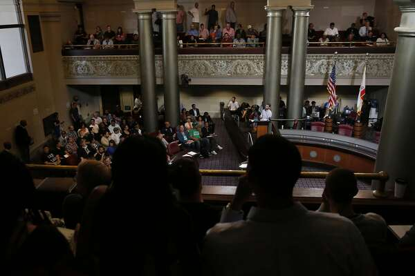 Greg Minor, Assistant to the City Administrator � Special Permits and Nuisance Abatement, leads a packed informational meeting hosted by the Cannabis Regulatory Commission in the City Council Chambers in City Hall July 21, 2016 in Oakland, Calif.