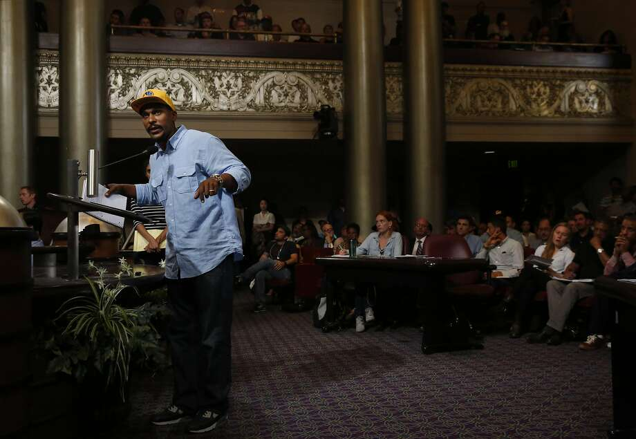 Anthony Limbrick asks a question about how born and raised Oakland residents and aspiring business owners can receive help during an informational meeting in the City Council Chambers in City Hall July 21, 2016 in Oakland, Calif. Photo: Leah Millis, The Chronicle