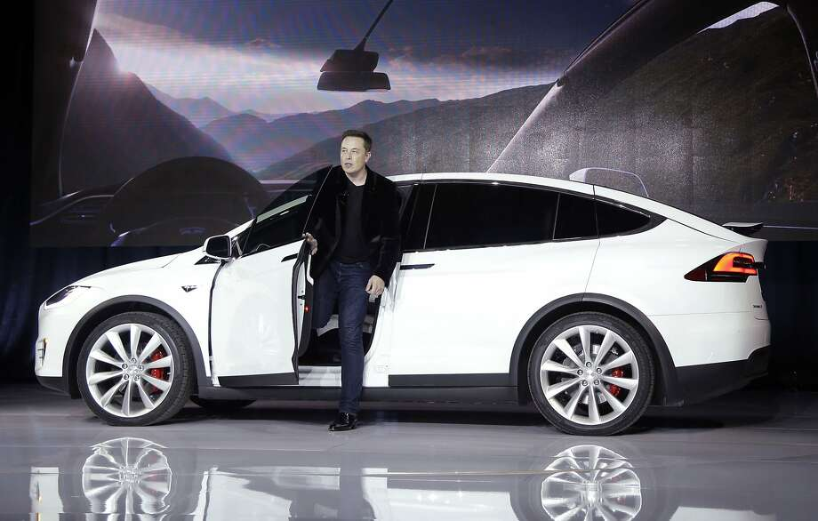 "FILE - In this Sept. 29, 2015 file photo, Elon Musk, CEO of Tesla Motors Inc., introduces the Model X car at the company's headquarters in Fremont, Calif. A Tesla in Autopilot mode can drive itself but it's not a ""self-driving"" vehicle, at least as far as safety regulators are concerned. So, instead of coming under heavy government scrutiny before being sold to the public, Tesla can mass-produce cars that automatically adjust speed with the flow of traffic, keep their lane and slam the brakes in an emergency. (AP Photo/Marcio Jose Sanchez, File) Photo: Marcio Jose Sanchez, Associated Press"
