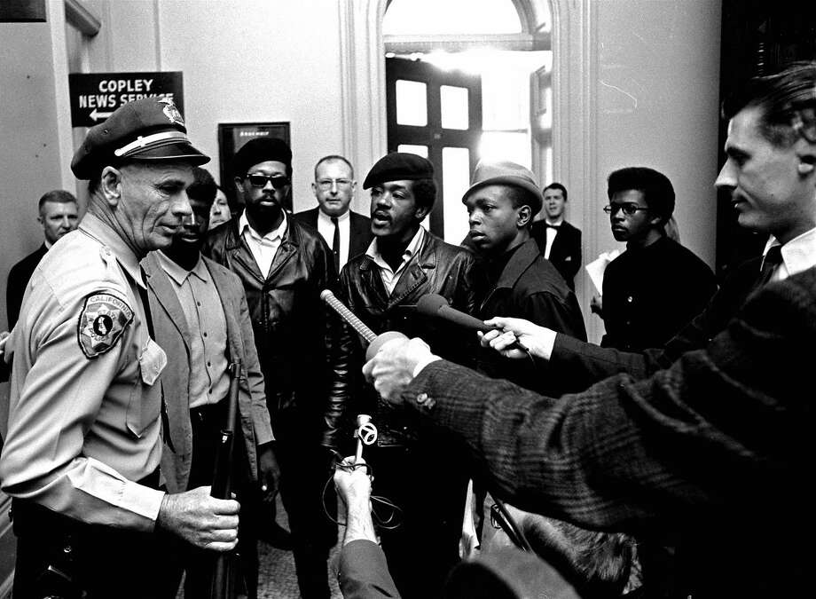 Black Panthers, including Eldridge Cleaver (in sunglasses) and Bobby Seale (center), argue with a California state police officer at the Capitol in Sacramento after he disarmed them on May 2, 1967. The armed Panthers entered the Capitol protesting a bill to restrict carrying arms in public. Photo: Associated Press 1967