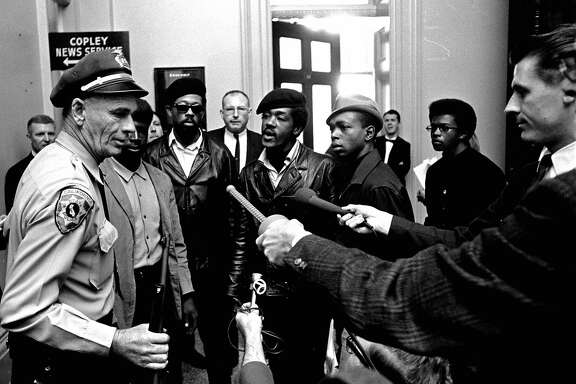 Members of the Black Panther Party argue with a California state policeman at the Capitol in Sacramento after he disarmed them May 2, 1967. The armed Panthers entered the Capitol protesting a bill before the Legislature that would restrict carrying arms in public. Men in berets at center are Panther leaders Eldridge Cleaver, left in sunglasses, and Bobby Seale. The policeman holds a weapon taken from the Panthers. (AP Photo)